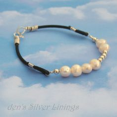 Pearl Sterling and Leather Bracelet with Hand by denssilverlinings, $35.00