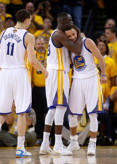 Golden State Warriors' Stephen Curry (30) gets a hug from Golden State Warriors' Draymond Green (23) during their game against the Cleveland Cavaliers late in the fourth quarter of Game 5 of the NBA Finals at Oracle Arena in Oakland, Calif., on Sunday, June 14, 2015. (Nhat V. Meyer/Bay Area News Group)