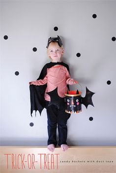 A Do-it-Yourself bat (or pumpkin) treat bucket from a tin can, adorned with cardboard wings and duct tape!
