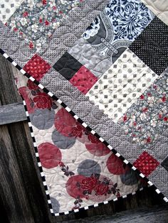 greys + red quilt.... Like the binding, too. . . .