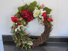 Hand crafted grapevine and floral wreath.