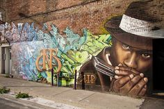 Montréal graffiti harmonica playing African American musician
