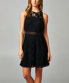 Adorned in lovely lace and boasting a flirty-chic silhouette, this dress promises charming desk-to-dinner style.