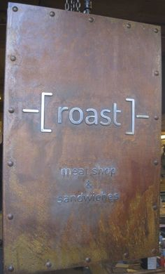 this is a 2 sided large metal sign, that went through the rusted process. Raised waterjet cut letters were then applied and buffed. Sign was then clear coated.