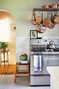 Subway tile kitchen with white floors and soft mint walls