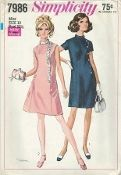 An original ca. 1968 Simplicity Pattern 7986.  A-line dress with princess seaming has stand up collar and back zipper closing. Button trimmed V1 has short set in sleeves. Sleeveless V2 has sequin trim.