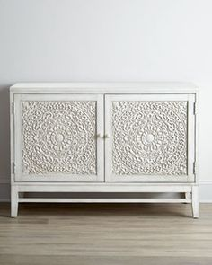 The Moroccan vibe on this gorgeous cabinet would be so beautiful in a dining room, or even as a smaller option for a TV console.