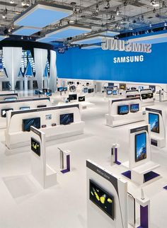 This revolutionary exhibit for Samsung Electronics Co. takes home the 2010 EDGE Award for Exhibit Design and Graphics Excellence. Trade Show Design, Display Design, Exhibition Booth Design, Exhibition Stands, Exhibit Design, Retail Store Design, Retail Shop, Showroom Interior Design, Electronic Shop