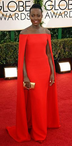 Lupita Nyong'o in Red Ralph Lauren Cape Dress with Monica Rich Kosann Clutch and Fred Leighton Jewelry