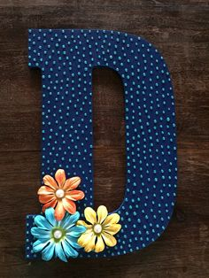 Wooden letter painted with navy blue acrylic paint. Embellished with Stickles, paper flowers, and flat back pearls. Collage Pauge used as a sealant. Painting Wooden Letters, Paper Mache Letters, Letter A Crafts, Painted Letters, Monogram Letters, Letter Art, Letter Standee, Wood Letters Decorated, Letter Door Hangers