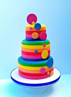Bright spotty rainbow stripe cake