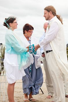 Wedding Ceremony - Handfasting, with aqua, white, purple handfasting cords.