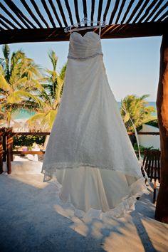The wedding dress over the beautiful exotic landscape of the white wedding - Emily & Rishi's destination wedding in Tulum