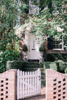 Brick fence and gate in front entry way.