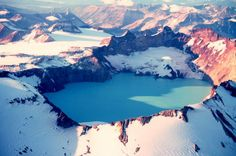 The summit caldera of Alaska's Katmai volcano formed by the collapse of its summit area due to massive withdrawal of magma during the June 6-9,1912 eruption.