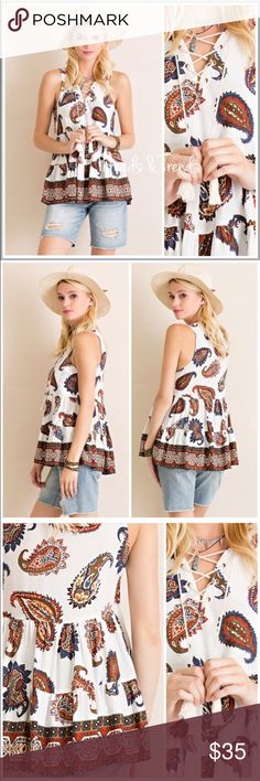 """Paisley Print Woven Top Ethnic paisley print top with lace up tassel tie front and tiered detail. Made of a rayon woven fabric. Beautiful colors of ivory, rust and blue. Size S, M, L white  tank top.                                        Small  Bust 36"""" Length 25""""  Medium  Bust 38"""" Length 26""""  Large Bust 42"""" Length  27"""" Threads & Trends Tops Tank Tops"""