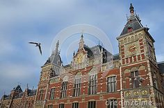 Central Station of Amsterdam,Netherlands, beautiful building view with seagulls
