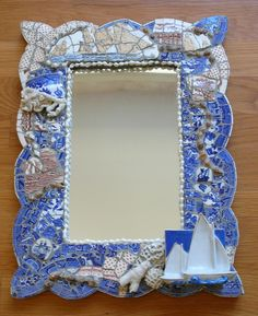 Jacobs' nautical mosaic mirror commission by Nancy Low. SOLD