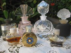 Pretty little vintage perfume bottles, some with awesome crystal stoppers. Love the gold one with blue rhinestone jewels!