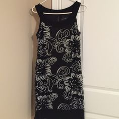 Black and White sequin dress Cute black and white sequin dress in like new condition. Worn once to a holiday party and has been in my closet ever since. No loose beading. I'm 5'2 and it comes about an inch above my knee Scarlett Nite Dresses Midi