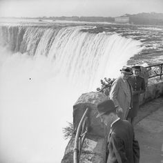 The Prime Minister Winston Churchill and his daughter, Mary, stand by the Horseshoe Fall, part of the Niagara Falls in Canada on 12 August 1943.