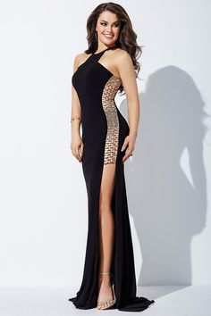 Showcasing metallic beaded illusion sides running from the bodice to the hips, this Jovani JVN35181 halter neck prom dress creates a fitted silhouette. This jersey gown features a racer back and the full-length skirt has side slits and a sweep train.