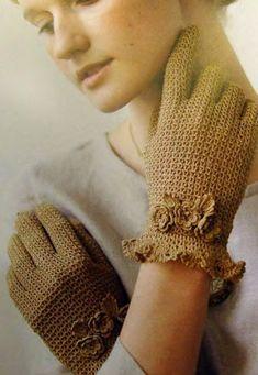 Fishnet gloves, decorated with miniature crocheted flowers crochet. Scheme knitting crochet gloves