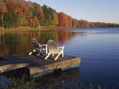 Adirondack Chairs on Dock at Lake Stretched Canvas Print by Ralph Morsch at Art.com