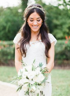 Love the flower crown and veil; nice half up half down style