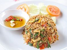 Spicy Thai Basil Fried Rice recipe. (consider experimenting with fish sauce and oyster sauce to optimize flavor) Rice Recipes, Easy Healthy Recipes, Asian Recipes, Vegetarian Recipes, Chicken Recipes, Dinner Recipes, Ethnic Recipes, Thai Basil Recipes, Recipe Chicken