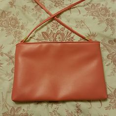 Medium pink clutch 10 X 5 inc. Basic salmon pink clutch, small mark on back. Never used. Bags Clutches & Wristlets