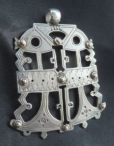 Africa   Tuareg Bella amulet from Mali. Silver.  20th century   79$ ~ Sold   The Bella live in Niger and Mali but are of Sudanese origin.  They used to be held in slavery by the Tuareg.