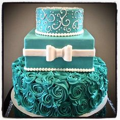 Turquoise cake with rosettes and white bow from Sweety Cakes