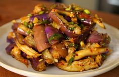 Eggplant & Soy Sauce Side Dish | Ingredients (serves 4):  1 pound of Korean eggplants (3-4 eggplants), capsremoved and washed 3 garlic cloves, minced 2 green onions, chopped 1 tablespoon soy sauce 1 teaspoon fish sauce 1 teaspoon hot pepper flakes 2 teaspoons sesame oil 1 tablespoon sesame seeds, crushed