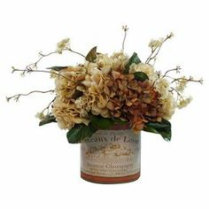 """Silk hydrangea arrangement in a glass planter with French typography.   Product: Faux floral arrangementConstruction Material: Glass, plastic, silicone and silkColor: Cream and rustFeatures: For indoor use onlyDimensions: 12"""" H x 12"""" Diameter"""