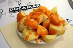 A big bowl of patatas bravas drizzled in bravas sauce is a common vegetarian tapa in Madrid that can be enjoyed by everyone