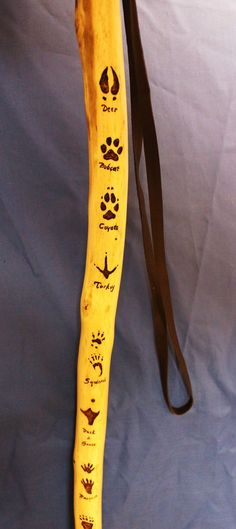 Hiking stick with animal track, just the pic but like the idea so when you are hiking you can identify the animal: