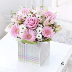 This charming jute bag filled with pretty pink flowers makes a very feminine gift for someone special. The soft shades of pastel pink with fresh white look wonderful together.  This is a lovely treat they'll be delighted to receive. If you would like to order this gift bag, give us a call on 0161 861 0524 and we'll be happy to help.