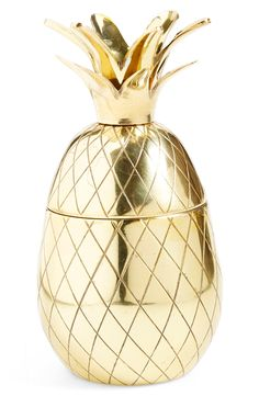 This golden pineapple tumbler does double duty as a charming decoration and a delightfully functional beverage holder.