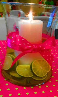 Hot pink polka dot ribbon, and green limes wedding Centerpiece #DIY #candles #decorations Could use orange slices and turquise ribbon  this would cut down on cost of flowers but still add color!