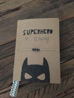 Notebook child -superhero in training