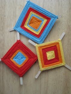 """All that was needed to make a """"God's Eye"""" was a couple popscicle sticks, a dab of glue and yarn. The question remains - who the heck thought these things represented God's Eye? Weird."""