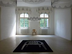 "Installation ""throne"" by Herman Steins, monobloc in bronze, handmade carpet and monotypes on tarlatane, 2012, ArToll Kunstlabor, Bedburg-Hau, Germany."