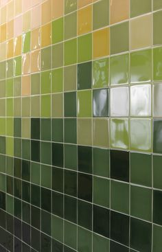 Vast array of different tones of green wall tile. From dark wine bottle shade to light lime green and sage. Bathroom and Kitchen.