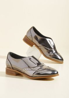 In a sea of metropolitan originality, you manage to rise above the tide in these pewter flats. A ModCloth-exclusive pair that combines brogue accents and leather-stacked heels with a laceless silhouette, these glossy slip-ons shake up street style with the same effortlessness it takes to don 'em!