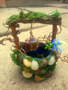 ~~~~~~Fairy Garden Wishing Well~~~~~~  100% handmade!  Miniature Fairy Garden Wishing Well,Fairy garden well. This well can be filled with water. It is plastic on the inside!  Made of beauriful river rocks i gathered from here and arround the villages in my country, there is some moss and i put flowers! In the bottom when you look, you will see water and coins! :) You can also put real water inside!  The Well comes with the bucket of magic water. The well will come to you, filled with real…