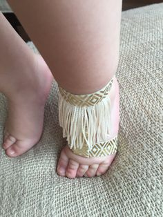 These gold and cream baby sandals are SO cute! Gold and cream elastic fit over the ankle and foot, and the accents make them so unique. A