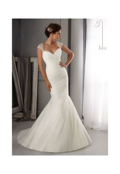 LOVE Wedding Gowns By Blu featuring 5270 Intricate Crystal Beading Design on Soft Net Colors Available: White/Silver, Ivory/Silver. Sizes Available: 2-28.