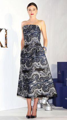 Miranda Kerr in an agate-printed Osman strapless tea-length dress