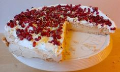 Lime & Pomegranate Pavlova - Guest Blog Post at Kitchen Moxie. Try it as an alternative Birthday Cake, Wedding Cake or dinner party dessert.